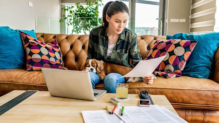 woman working from home in the company of her puppy.