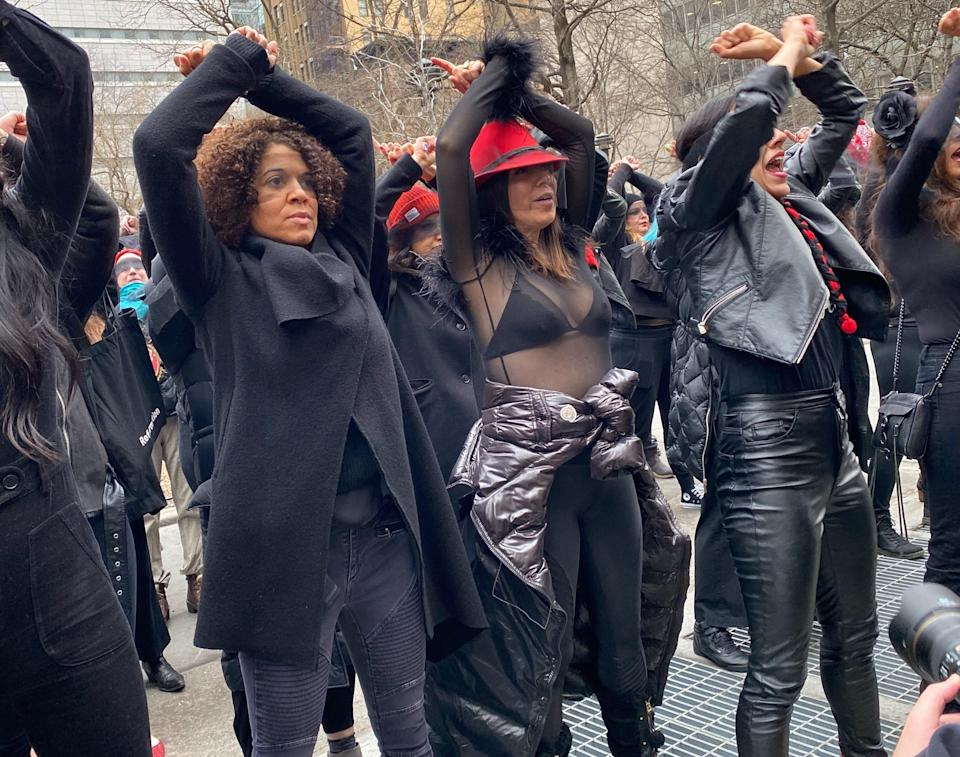 """A group of women activists perform the Chilean anti-rape anthem """"A Rapist In Our Path"""" outside of the courthouse where Harvey Weinstein's trial is ongoing. (Photo: Emma Gray for HuffPost)"""