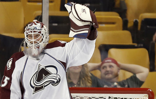 Colorado Avalanche goalie Jean-Sebastien Giguere celebrates after the Avalanche defeated the Boston Bruins 2-0 in an NHL hockey game in Boston on Thursday, Oct. 10, 2013. (AP Photo/Winslow Townson)