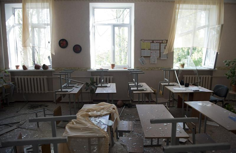 A classroom is damaged school in Donetsk, Ukraine, on October 1, 2014, after a shell exploded nearby (AFP Photo/John Macdougall)