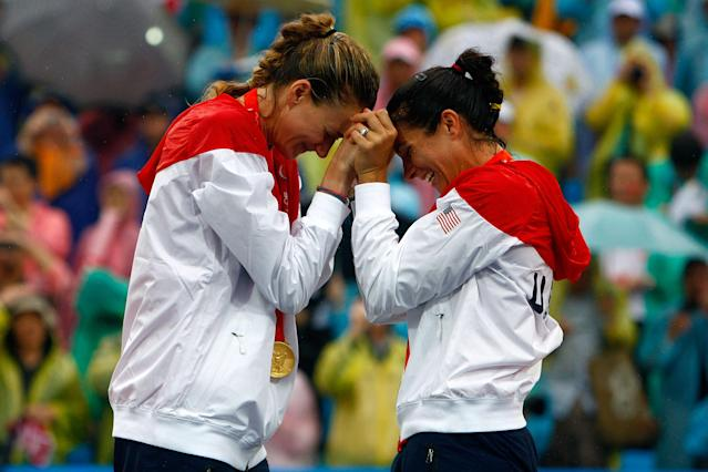 BEIJING - AUGUST 21: Gold medalists Kerri Walsh and Misty May-Treanor of the United States celebrate after winning the women's gold medal match against China held at the Chaoyang Park Beach Volleyball Ground during Day 13 of the Beijing 2008 Olympic Games on August 21, 2008 in Beijing, China. (Photo by Jamie Squire/Getty Images)