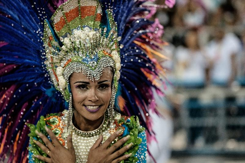 A dancer with the Uniao da Ilha samba school performs during the first night of the carnival parade at the Sambadrome in Rio de Janeiro, on February 7, 2016 (AFP Photo/Yasuyoshi Chiba)