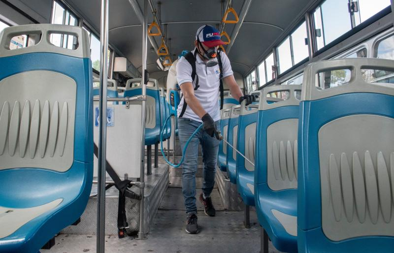 A worker disinfects a bus as a preventive measure against the spread of the new coronavirus, COVID-19, in San Jose, Costa Rica, on March 18, 2020. (Photo by Ezequiel Becerra / AFP) (Photo by EZEQUIEL BECERRA/AFP via Getty Images)