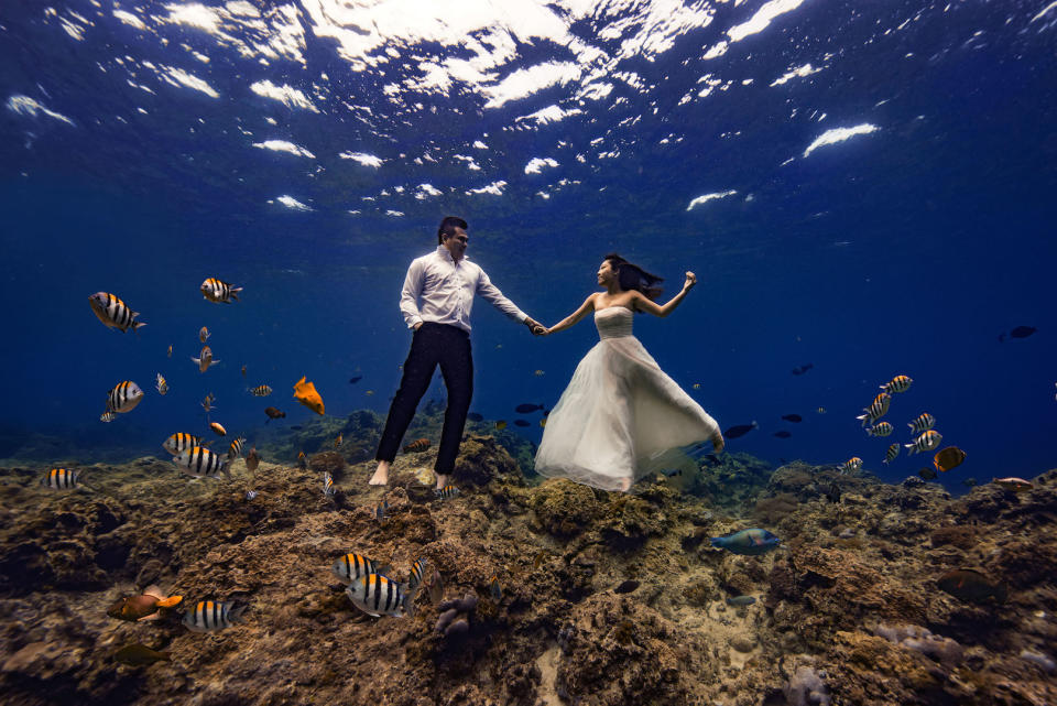 Couple pose for underwater wedding shoot [Photo: Caters]