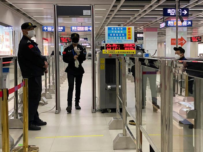 Security personnel at a checkpoint in Wuhan on April 01, 2020.