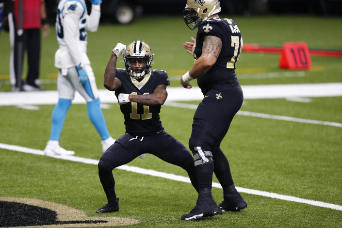 New Orleans Saints wide receiver Deonte Harris (11) celebrates his touchdown reception with center Erik McCoy (78) at the end of the first half of an NFL football game against the Carolina Panthers in New Orleans, Sunday, Oct. 25, 2020. (AP Photo/Brett Duke)