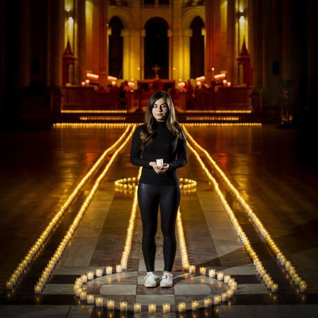Holly Wilson, whose grandmother Ada Wilson died during the pandemic, in Belfast Cathedral before a remembrance service