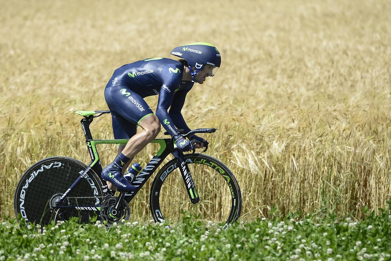 Spain's Ion Izagirre Insausti of team Movistar  cycles during the 7th stage, a 24.5 km race against the clock from Worb to Worb, at the 78. Tour de Suisse UCI ProTour cycling race, in Muensingen, Switzerland, Friday, June 20, 2014. (AP Photo/Keystone,Jean-Christophe Bott)