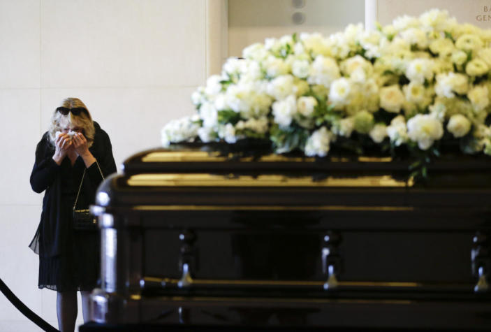 <p>A woman wipes a tear away as she pauses beside the casket of Nancy Reagan at the Ronald Reagan Presidential Library, on Wednesday, March 9, 2016, in Simi Valley, Calif. <i>(Photo:Jae C. Hong/AP)</i></p>