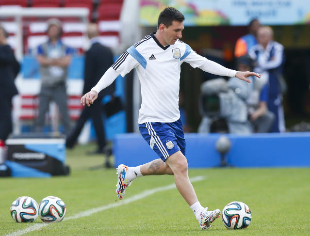 Argentina's Lionel Messi, right, kicks a ball during a training session at the Beira-Rio Stadium in Porto Alegre, Brazil, Tuesday, June 24, 2014. Argentina plays in group F of the 2014 soccer World Cup. (AP Photo/Victor R. Caivano)