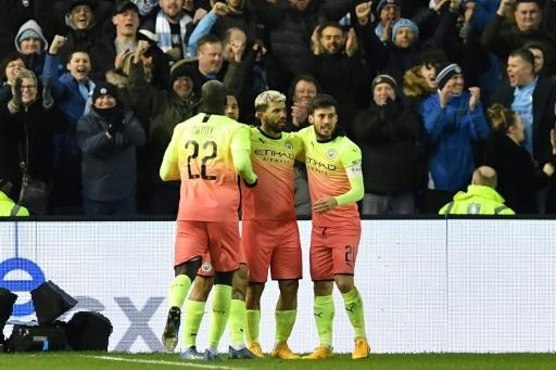 Sergio Aguero (centre) scored the only goal against Sheffield Wednesday to take Manchester City into the FA Cup quarter-finals