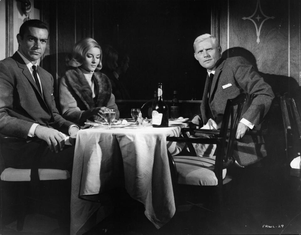 Daniela Bianchi ,Sean Connery and Robert Shaw sitting at a dining table together in a scene from the film 'James Bond: From Russia With Love', 1963. (Photo by United Artist/Getty Images)
