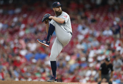 Cleveland Indians starting pitcher Corey Kluber throws against the Cincinnati Reds during the first inning of a baseball game, Tuesday, Aug. 14, 2018, in Cincinnati. (AP Photo/Gary Landers)
