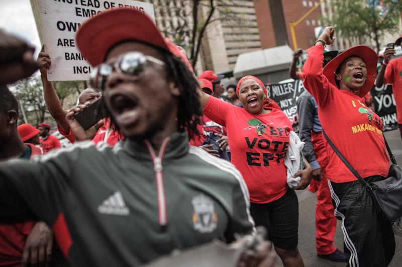 The marches were originally planned to show support for Finance Minister Pravin Gordhan, who had been due in court Wednesday on separate graft charges that many analysts see as an attempt by Zuma loyalists to oust him (AFP Photo/Gianluigi Guercia)