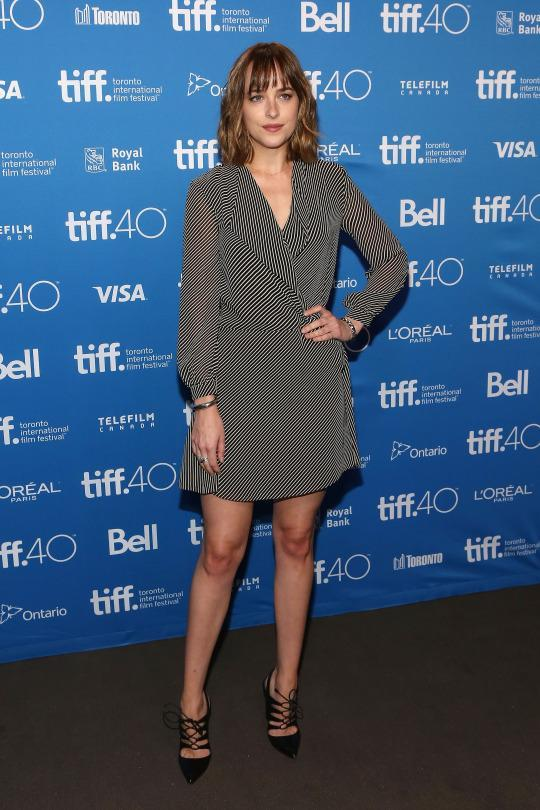 "<p>For the ""Black Mass"" photocall, Dakota Johnson was all business in a very professional look. The black and white wrap dress could've been worn in an office as well as a press conference, and because she's a movie star she added some sexy strappy high heels.</p>"