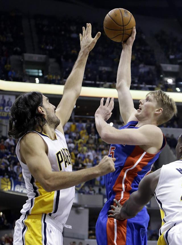 Detroit Pistons forward Kyle Singler, right, shoots over Indiana Pacers forward Luis Scola in the first half of an NBA basketball game in Indianapolis, Monday, Dec. 16, 2013. (AP Photo/Michael Conroy)