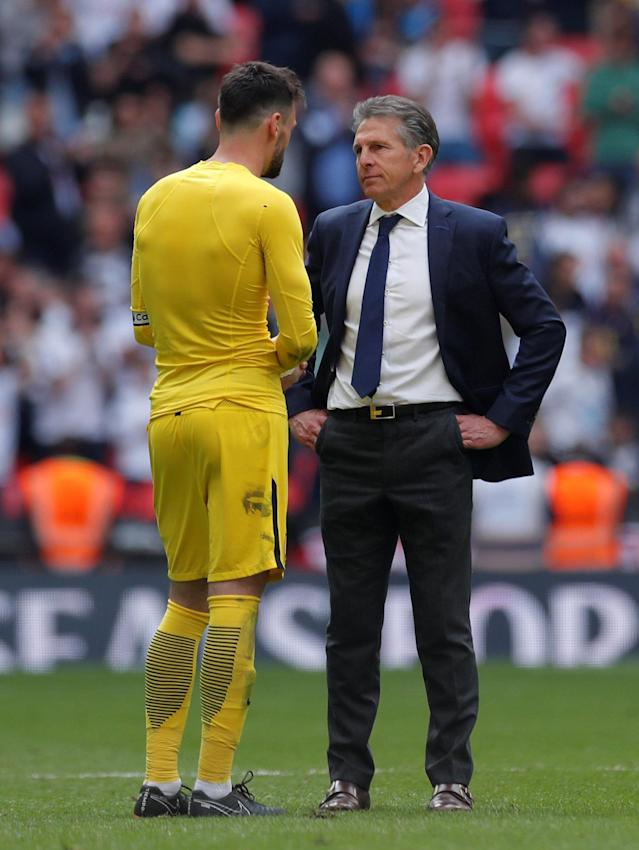 "Soccer Football - Premier League - Tottenham Hotspur vs Leicester City - Wembley Stadium, London, Britain - May 13, 2018 Leicester City manager Claude Puel with Tottenham's Hugo Lloris after the match Action Images via Reuters/Andrew Couldridge EDITORIAL USE ONLY. No use with unauthorized audio, video, data, fixture lists, club/league logos or ""live"" services. Online in-match use limited to 75 images, no video emulation. No use in betting, games or single club/league/player publications. Please contact your account representative for further details."