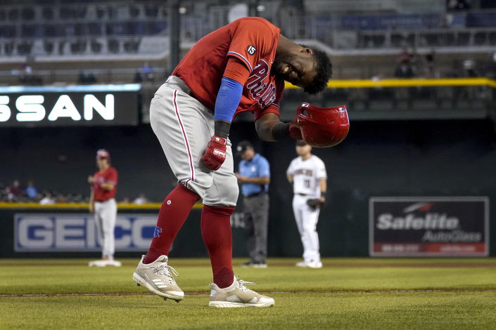 Philadelphia Phillies center fielder Odubel Herrera reacts after being hit by a pitch during the eighth inning of a baseball game against the Arizona Diamondbacks, Thursday, Aug. 19, 2021, in Phoenix. (AP Photo/Matt York)