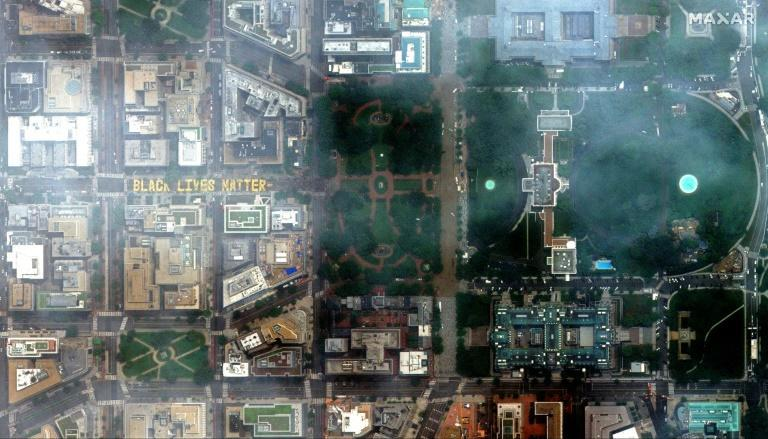 """This handout satellite image released by Maxar Technologies shows a giant street mural reading """"Black Lives Matter"""" at 16th street near the White House in Washington, DC on June 6, 2020"""