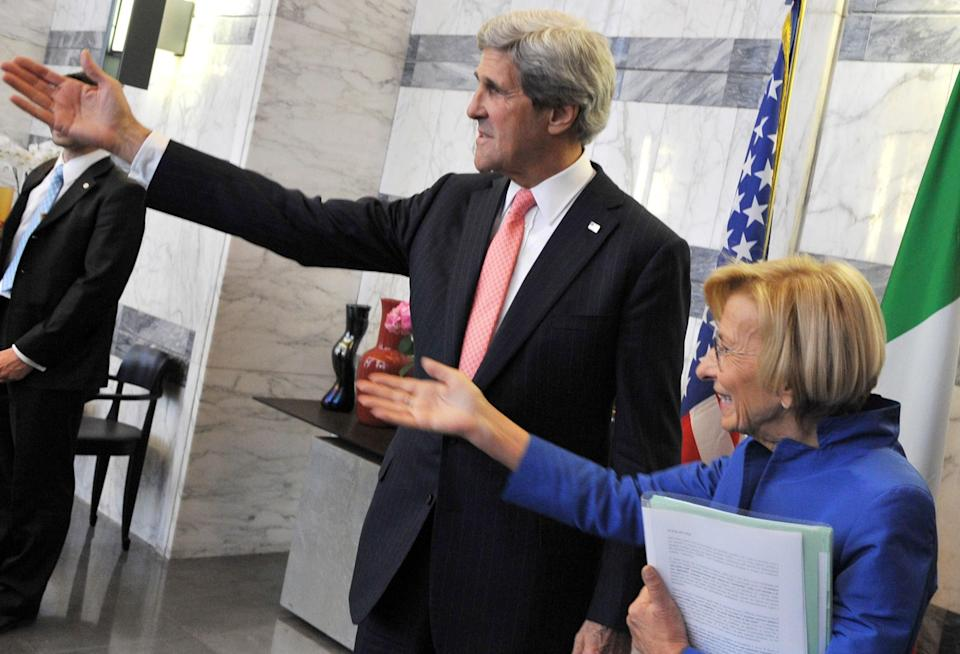 Italian Foreign Minister Emma Bonino, right, and US Secretary of State John Kerry invite their colleagues for talks prior to an official meeting in the Foreign Ministry building in Rome on Thursday May 9, 2013. (AP Photo/Mladen Antonov, Pool)