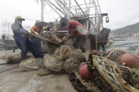 Fishermen organize fishing nets to take shelter as Typhoon Chanthu approaches to Taiwan in Keelung, New Taipei City, Taiwan, Saturday, Sept. 11, 2021. Taiwan's weather bureau warned of high winds and heavy rain as Typhoon Chanthu roared toward the island Saturday and said the storm's center was likely to pass its east coast instead of hitting land. (AP Photo/Chiang Ying-ying)