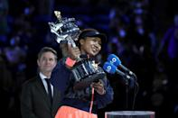 Naomi Osaka holds the Australian Open's Daphne Akhurst Memorial Cup after beating Jennifer Brady in the 2021 final on Saturday
