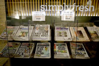 Newspapers headlining Prince Harry and Meghan's explosive TV interview are displayed for sale outside a shop in London, Tuesday, March 9, 2021. Britain's royal family is absorbing the tremors from a sensational television interview by Prince Harry and the Duchess of Sussex, in which the couple said they encountered racist attitudes and a lack of support that drove Meghan to thoughts of suicide. (AP Photo/Frank Augstein)