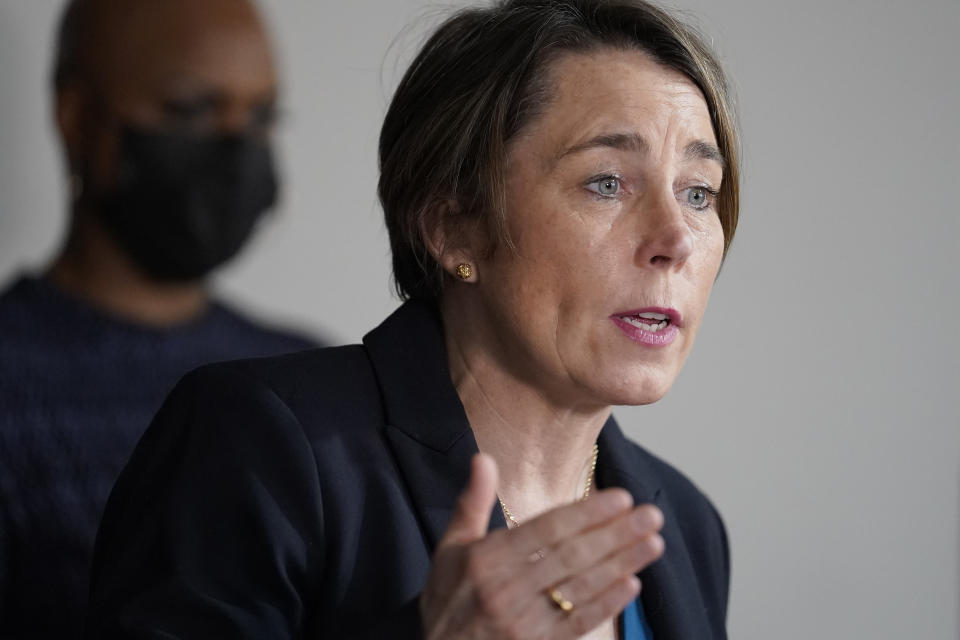 FILE - In this April 1, 2021 file photo, Mass. Attorney General Maura Healey, right, responds to questions from reporters during a news conference in Boston. A congressional committee heard grievances Tuesday, June 8, 2021 against the owners of OxyContin maker Purdue Pharma amid a longshot effort to advance legislation that would keep them from using the corporate bankruptcy process as a shield for personal liability. Healey said she would like to see the bill adopted before an Aug. 9 hearing on Purdue's restructuring plan. (AP Photo/Steven Senne, file)