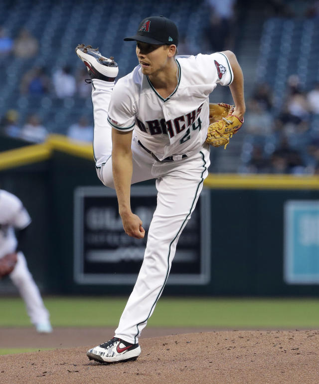 Arizona Diamondbacks starting pitcher Luke Weaver watches a delivery to a Pittsburgh Pirates batter during the first inning of a baseball game Tuesday, May 14, 2019, in Phoenix. (AP Photo/Matt York)