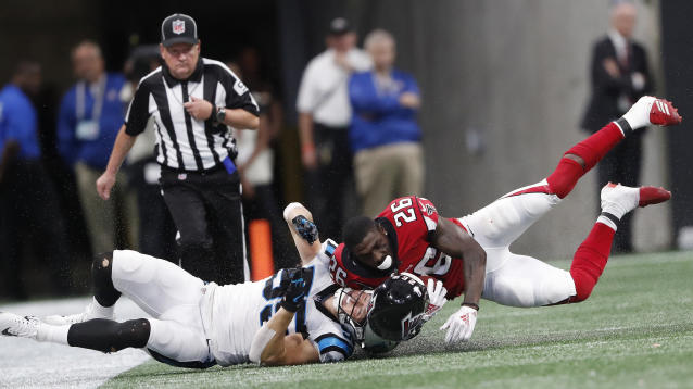 <p>Atlanta Falcons running back Tevin Coleman (26) his hit by Carolina Panthers linebacker David Mayo (55) during the second half of an NFL football game, Sunday, Sept. 16, 2018, in Atlanta. (AP Photo/John Bazemore) </p>