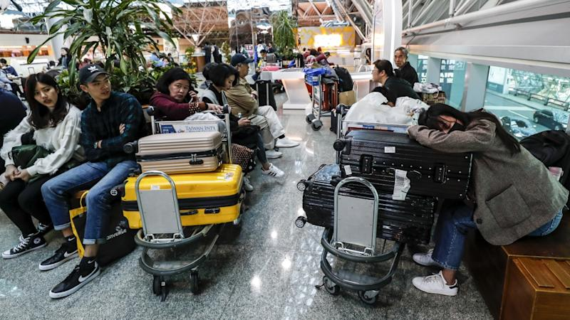 China Airlines promises compensation to stranded passengers as pilot strike continues