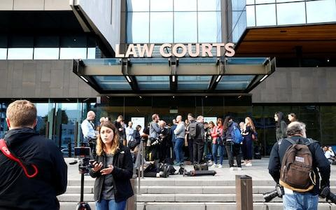 <span>Media gathered outside the district court in Christchurch</span> <span>Credit: Edgar Su/Reuters </span>