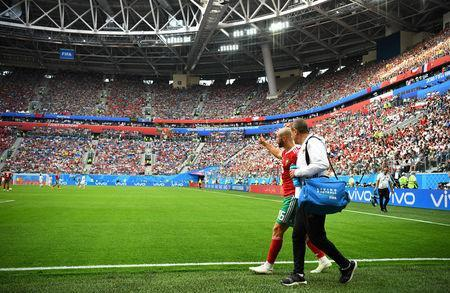 Soccer Football - World Cup - Group B - Morocco vs Iran - Saint Petersburg Stadium, Saint Petersburg, Russia - June 15, 2018 Morocco's Nordin Amrabat gestures to team mates as he is substituted off after sustaining an injury REUTERS/Dylan Martinez