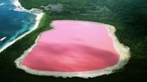 <p>Believe it or not, this bubblegum pink lake in Western Australia is completely natural. The 2,000ft-long pool of rosy water is surrounded by a rim of sand and dense woodland, and scientists believe its unusual colour is caused by the salt-loving algae that inhabit it. (Photo: Flickr / Buy Cruise Holidays)</p>