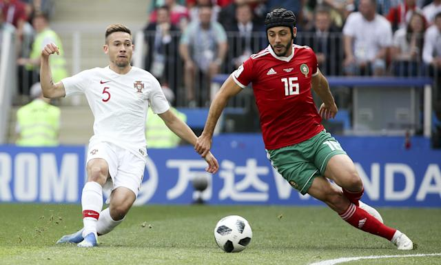 Nordin Amrabat started the match against Portugal wearing a scrum cap but jettisoned it.