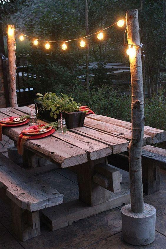 """<p>Make these DIY string light poles to create a simple overhang for your backyard picnic table.</p><p><strong>Get the tutorial at <a href=""""http://blog.homedepot.com/string-light-pole-with-concrete-base/?crlt.pid=camp.PGTN7tVfGK4B"""" rel=""""nofollow noopener"""" target=""""_blank"""" data-ylk=""""slk:Home Depot"""" class=""""link rapid-noclick-resp"""">Home Depot</a>.</strong></p><p><strong><a class=""""link rapid-noclick-resp"""" href=""""https://www.amazon.com/Backyard-Hanging-Outdoor-Pergola-Deckyard/dp/B00RQHBZVS/ref=sr_1_5?tag=syn-yahoo-20&ascsubtag=%5Bartid%7C10050.g.3404%5Bsrc%7Cyahoo-us"""" rel=""""nofollow noopener"""" target=""""_blank"""" data-ylk=""""slk:Shop string lights"""">Shop string lights</a><br></strong></p>"""