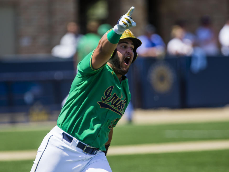 FILE - Notre Dame's Niko Kavadas (12) celebrates a home run against Central Michigan during an NCAA tournament college baseball game in South Bend, Ind., in this Friday, June 4, 2021, file photo. Home runs — lots and lots of them — have defined the NCAA baseball tournament so far. A total of 381 have been hit in 123 games, the highest total through super regionals since at least 2005. (Michael Caterina/South Bend Tribune via AP, File)