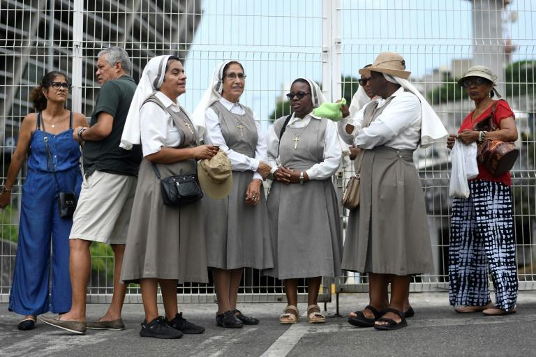 Nuns queue for the canoninization ceremony of Brazil's first female saint in Salvador, Bahia, October 20, 2019