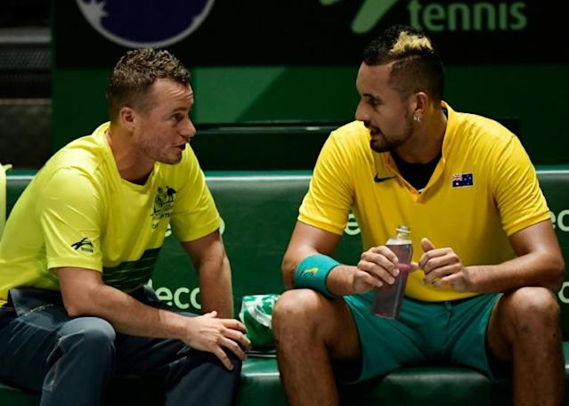 """""""I think we can win it for sure."""" Australia's Nick Kyrgios (right) talks to captain Lleyton Hewitt during his victory against against Colombia's Alejandro Gonzalez (AFP Photo/JAVIER SORIANO)"""