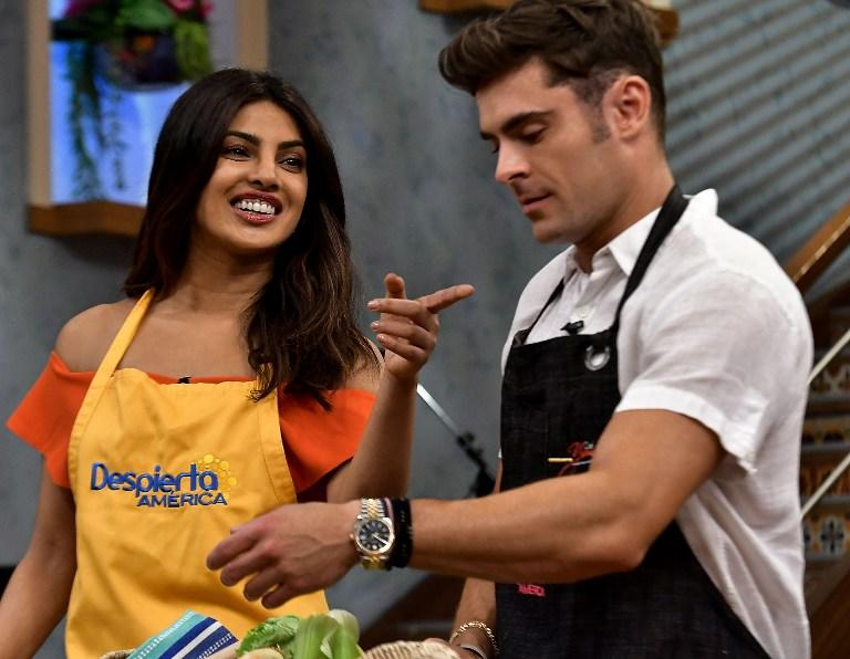 <p>Priyanka Chopra and Zac Efron is on the set of 'Despierta America' to promote the film 'Baywatch' at Univision Studios on May 12, 2017 in Miami, Florida. Gustavo Caballero/Getty Images/AFP </p>