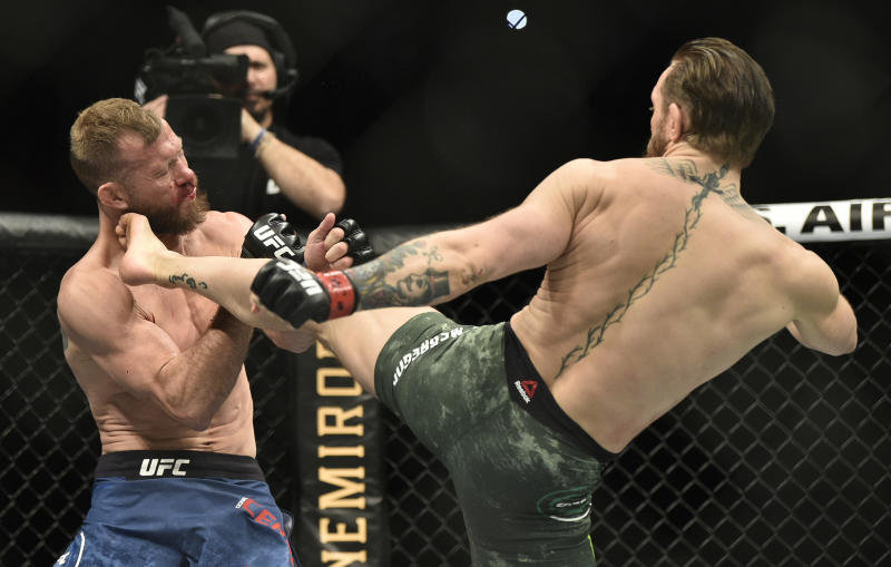 LAS VEGAS, NEVADA - JANUARY 18: Conor McGregor of Ireland kicks Donald Cerrone in their welterweight fight during the UFC 246 event at T-Mobile Arena on January 18, 2020 in Las Vegas, Nevada. (Photo by Chris Unger/Zuffa LLC)