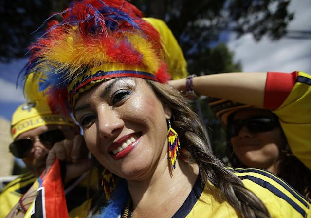 A Columbian fan has her headgear adjusted before the group C World Cup soccer match between Colombia and Greece at the Mineirao Stadium in Belo Horizonte, Brazil, Saturday, June 14, 2014. (AP Photo/Andrew Medichini)