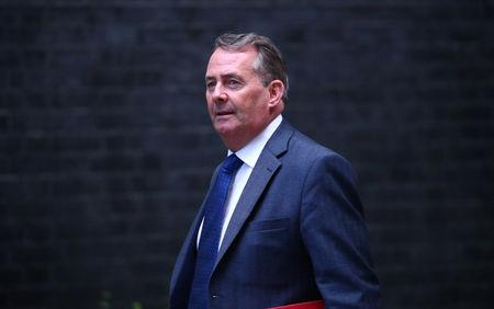 Britain's Secretary of State for International Trade Liam Fox arrives in Downing Street, London