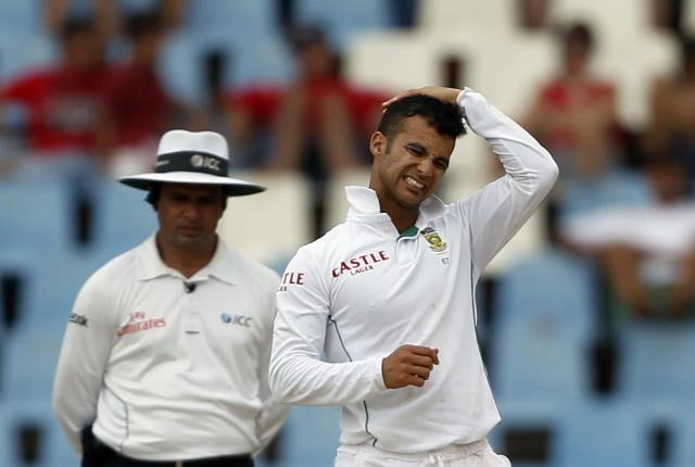 South Africa's JP Duminy reacts during the third day of their cricket test match against Australia in Centurion February 14, 2014. REUTERS/Siphiwe Sibeko (SOUTH AFRICA - Tags: SPORT CRICKET)