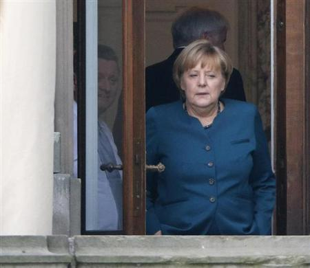 German Chancellor Merkel takes break during preliminary coalition talks in Berlin