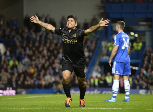 """Manchester City's Sergio Aguero celebrates scoring a goal against Chelsea during their English Premier League soccer match at Stamford Bridge in London October 27, 2013. REUTERS/Paul Hackett (BRITAIN - Tags: SPORT SOCCER) FOR EDITORIAL USE ONLY. NOT FOR SALE FOR MARKETING OR ADVERTISING CAMPAIGNS. NO USE WITH UNAUTHORIZED AUDIO, VIDEO, DATA, FIXTURE LISTS, CLUB/LEAGUE LOGOS OR """"LIVE"""" SERVICES. ONLINE IN-MATCH USE LIMITED TO 45 IMAGES, NO VIDEO EMULATION. NO USE IN BETTING, GAMES OR SINGLE CLUB/LEAGUE/PLAYER PUBLICATIONS"""