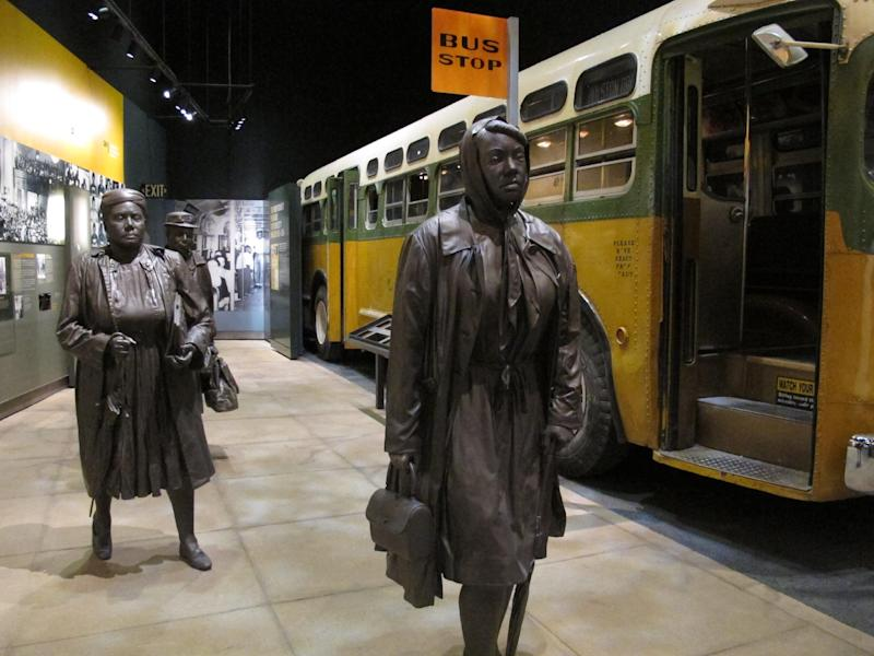 FILE - This March 19, 2014 photo shows statues of three women walking next to a replica of a city bus, part of an exhibit about Montgomery's bus boycotts at the newly-renovated National Civil Rights Museum in Memphis, Tenn. The museum, which first opened in 1991, is now ready to show off new, emotionally-moving exhibits and flashy, informative interactive displays. The museum says it attracts 200,000 people every year, but the renovations are impressive enough that they could lead to a spike in visitor turnout. (AP Photo/Adrian Sainz)