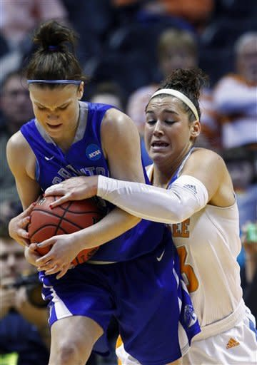 Tennessee forward Taber Spani, right, battles for the ball with Creighton guard Jordan Garrison in the first half of a second-round game in the women's NCAA college basketball tournament on Monday, March 25, 2013, in Knoxville, Tenn. (AP Photo/Wade Payne)