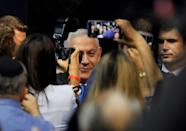 With a hoarse voice and appearing haggard after days of intense campaigning, Israeli PM Benjamin Netanyahu said he was prepared for negotiations to form a 'strong Zionist government' (AFP Photo/Menahem KAHANA)