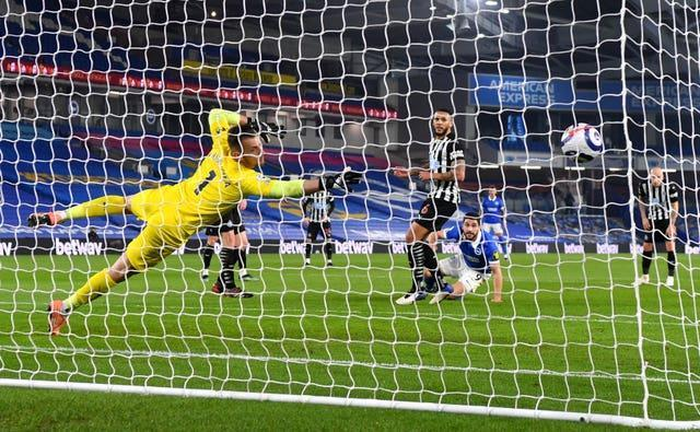 Neal Maupay scores the third goal in Newcastle's 3-0 loss to Brighton (Mike Hewitt/PA).